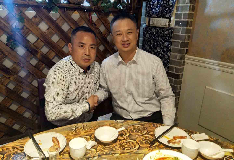 马总与荷兰皇家帝斯曼公司大中华区销售总监李晓毅合影